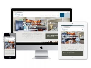 The Flats apartment website displayed on multiple screens